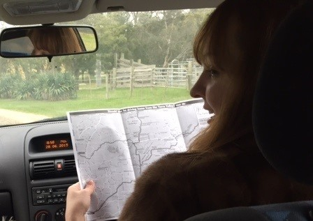 Kirsten Cameron reading a map in a car